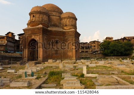 Graves surround the Tomb of Budshah, a popular tourist attraction in Srinagar, Kashmir, India. Horizontal copy space