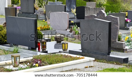 graves with grave stones at a cemetery in spring