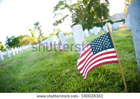 Gravesites at Arlington National Cemetery are decorated with flags in an annual Memorial Day tradition