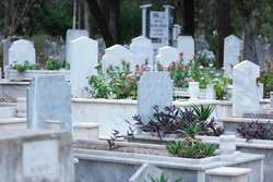 Gravestones and graves at Muslim cemetery. Graves background.