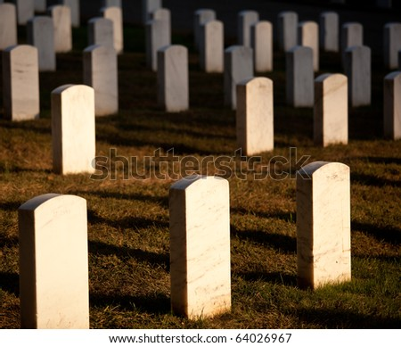 Gravestones lit by the setting sun in Arlington Cemetery