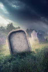 graveyard with fog and dramatic lighting