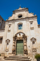 Gravina in Puglia, Italy. The ancient Church of Purgatory (S. Maria del Suffragio), with its beautiful portal surmounted by two statues of skeletons.