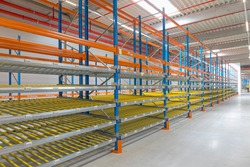 Gravity Flow Rack Shelving in Distribution Warehouse