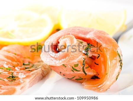 gravlax slices with lemon on white