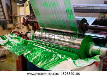 Gravure plastic bag printing machines are working at a high speed to print images with color in the factory. Photo stock ©
