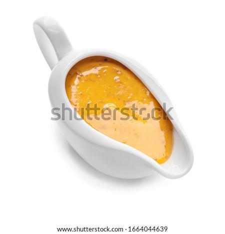 Gravy boat of tasty honey mustard sauce on white background Сток-фото ©