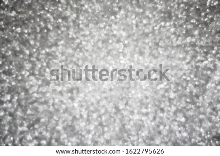 Gray abstract background with bokeh. Holiday sparkles
