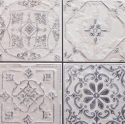 Gray ancient ceramic tiles with floral pattern for wall and floor decoration. Concrete stone surface background. Texture with retro ornament for interior design project.