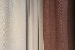Gray and red curtains, blackout curtains. Close-up. Herringbone cotton pattern, cotton fabric background texture. Interior material background.