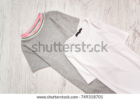 Gray and white dress on a wooden background. Fashionable concept #749318701