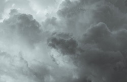 Gray and white fluffy clouds. Cloudy sky. White and gray texture background for sad, death, hopeless, and despair concept. Moody sky. Cloudscape. Dark dramatic sky. Background for dead and gloomy.