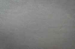 gray artificial leather, skin texture. leatherette background