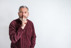 gray bearded man have the finger on lips as man gesturing shh sign, please be silent concept.