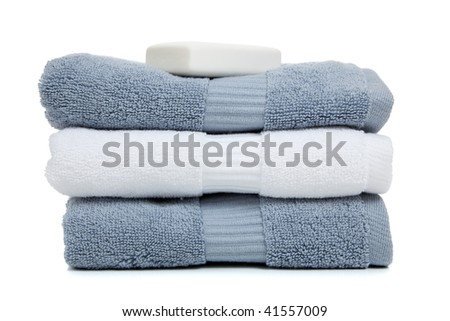 blue and white towels with a white bar of soap on a white ...