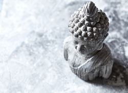 Gray Buddha Statue on Stone Background