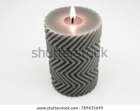 Gray candle with flame and zigzag pattern #789435649