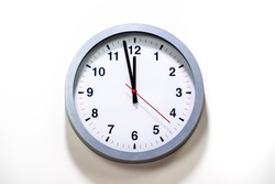 Gray clock face of a wall clock show the time. It's close to 12 o'clock. The latest report of the atomic scientist shows the doomsday clock 100 seconds to twelve.  Time is running out for mankind.