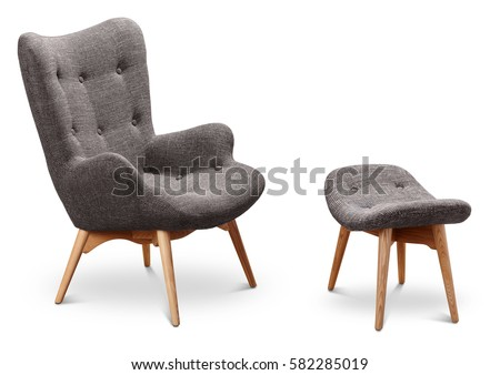 Gray color armchair and small chair for legs. Modern designer armchair on white background. Textile armchair and chair. Series of furniture.