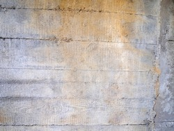 Gray concrete background with rough surface and brown stain. Wood texture.