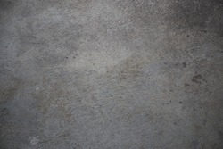 Gray concrete wall consisting of cement, stone and sand