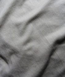 gray creased material background or texture