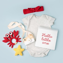 Gray cute baby bodysuit with mock up card. Set of kids clothes and accessories. Fashion newborn. Flat lay, top view