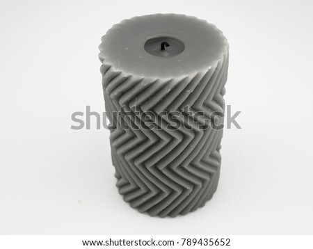 Gray decorated candle with zigzag pattern #789435652