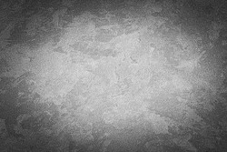 Gray decorative plaster texture with vignette. Abstract grunge background with copy space for design.
