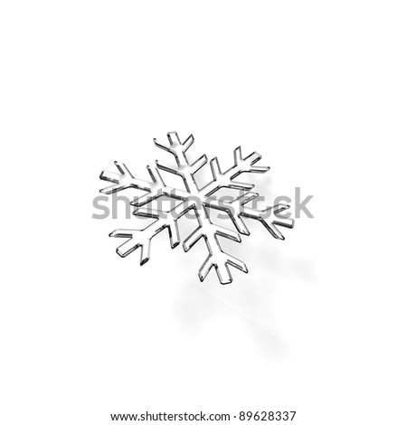 Gray glass snowflake on white