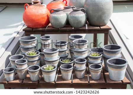 Gray, grained clay flower pots, shop window for gardening and growing potted plants and flowers. Capacity for flowers, vase flowerpot pot container #1423242626