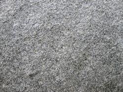 Gray grainy stone texture. Grainy surface.