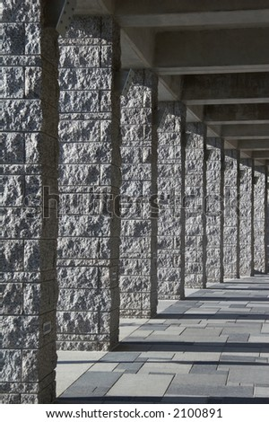 gray granite pillar - roofed course with light and shadows - portrait format