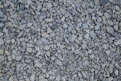 Gray gravel, lot of small beautiful stones, monochromatic backgrond.