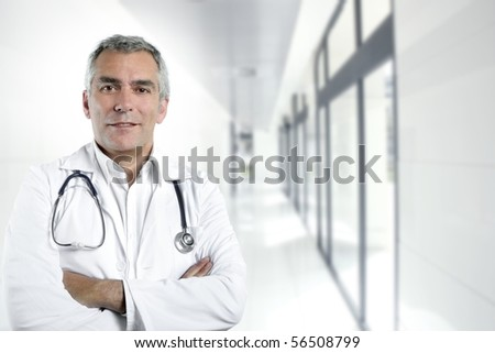 gray hair expertise handsome senior doctor hospital portrait white corridor [Photo Illustration]