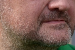 gray hair full beard close-up with nose and lips of the man