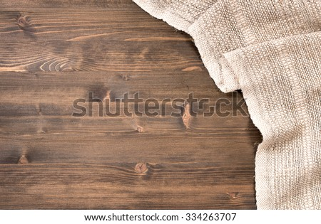 Gray handmade tablecloth from right side wooden table top view. Food background