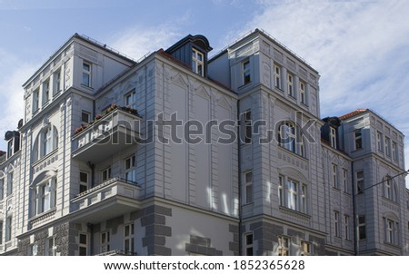 Gray historic tenement house in the Old Town of Poznan, Poland. Beautiful facade of a renovated tenement house.