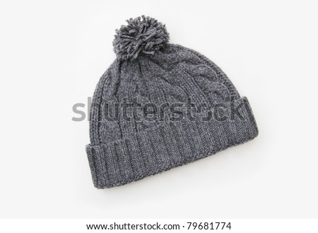 Gray knitted wool hat with Pom Pom isolated on white background