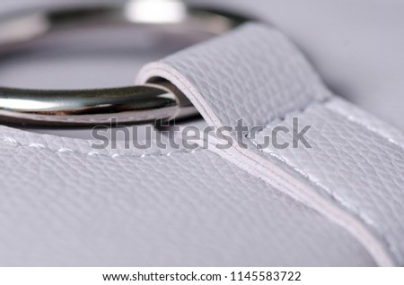 Gray leather bag fittings macro texture on blur background