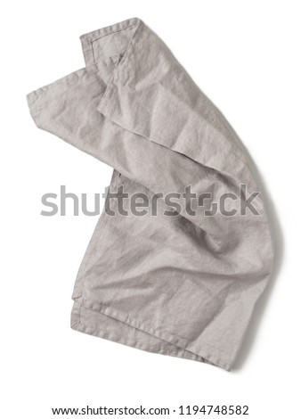 gray linen napkin isolated on white background. Natural light gray linen napkin. Isolated on white with clipping path. Top view or flat lay.