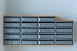 gray mailboxes on the blue wall of entrance of apartment house