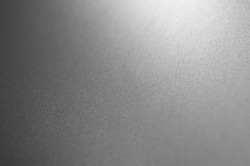Gray metal background, gradient from white to black .
