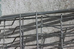 gray metal grating near the concrete wall