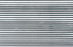 Gray metal shutters. Background of horizontal galvanized sheet metal texture.