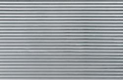 Gray metal shutters. Background of horizontal galvanized sheet metal texture.