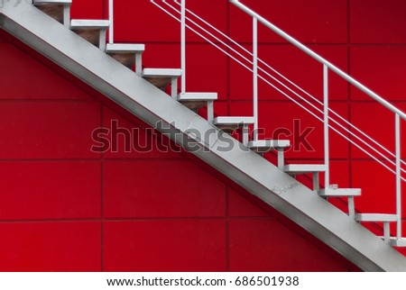 gray metal stair on the red wall. minimalism concept #686501938