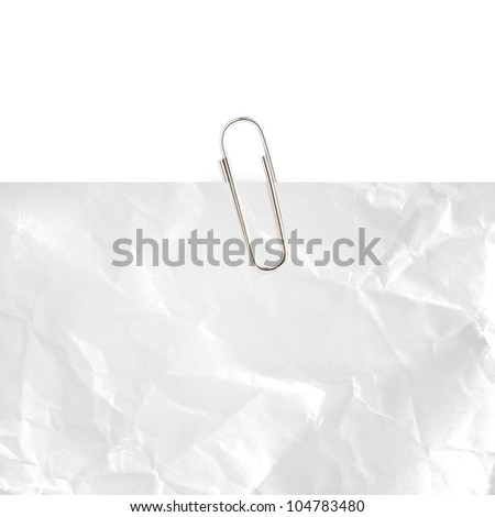 Gray note paper with paper clip on white background.