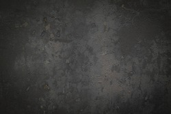 Gray or black concrete background with rough texture and dirt.