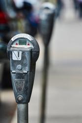 Gray parking meter in use in London, UK